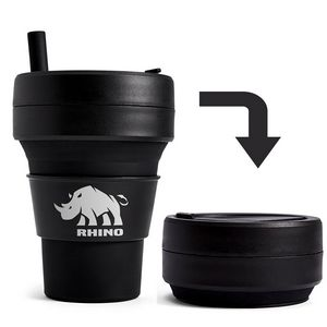 A black coffee cup with a straw and a picture of a rhino. To its right is a black disk, which is the coffee cup collapsed