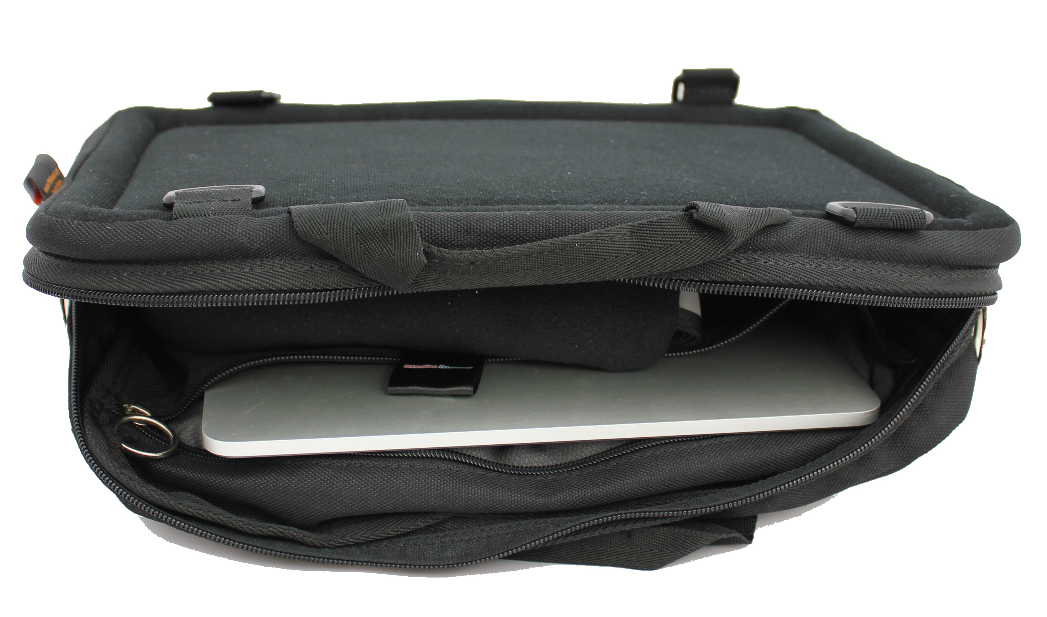The Trabasack Mini Connect is a black rectangular bag, which opens along a long edge of the rectangle. Inside it there is an ipad visible. The surface of the bag looks slightly soft (due to the velcro surfacing) and the bag has lots of D rings visible round the edges.